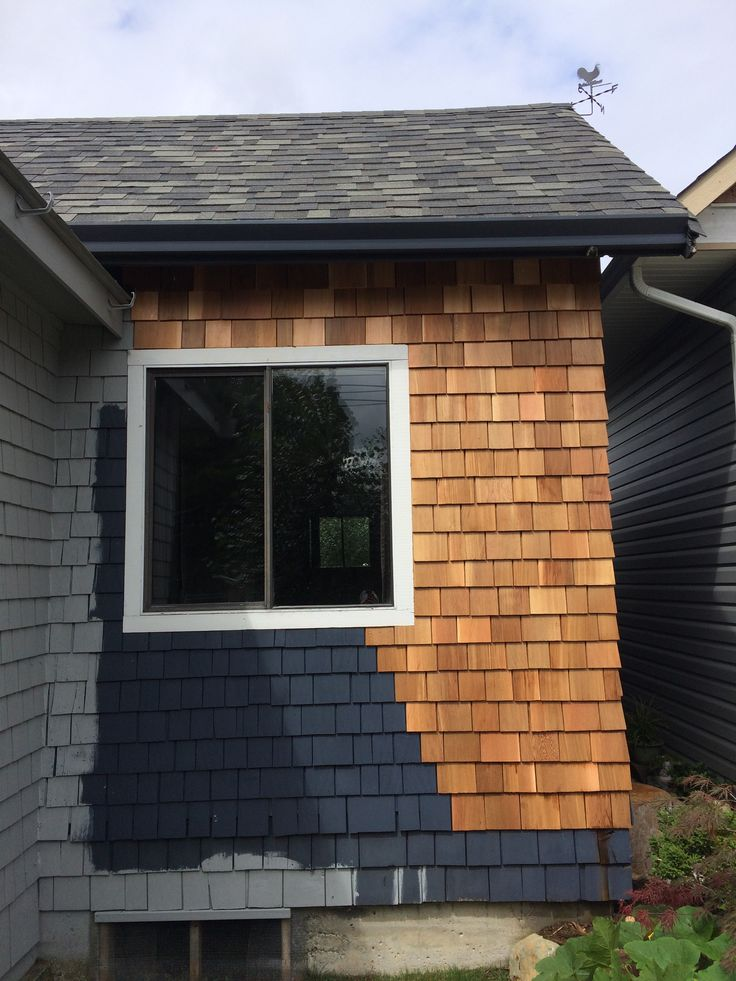 new gray paint, old blue color and new raw shingles lol, what a combo.