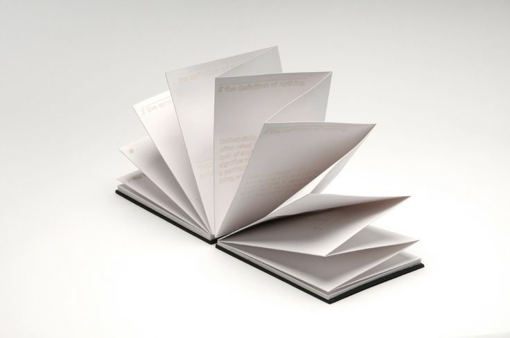 Taking the aspect of a book but with also a layout of a broadsheet that folds out.
