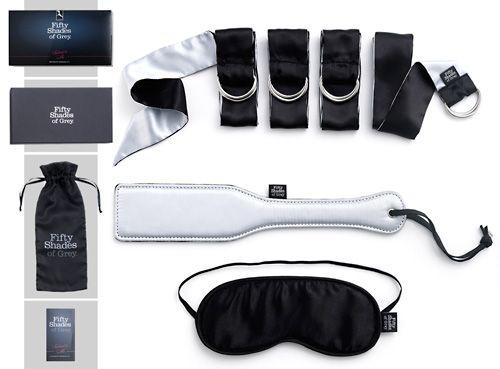 Fifty Shades of Grey virallinen tuotesarja!Hienostunut S/M ja bondage-setti sisältää satiinilla päällystetyt, pehmeät silmälaput, satiiniset, pitkät ranne/nilkkaremmit sekä satiini/keinonahkapäällysteisen lätkän. Pitkät silkkiset nauhat ovat varustettu metallirenkailla. Voit sitoa kumppanisi käde