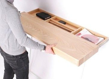 Neat hidden storage idea...make a floating shelf with hidden drawer pulls and space inside.
