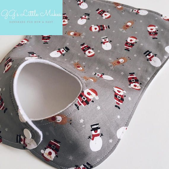 Christmas super absorbent full bib will compliment any outfit. Every peice of fabric is cut differently making each item truly unique DETAILS •Made with high quality 100% cotton fabric with soft absorbent PUL fleece backing . •plastic snap fasteners. •Each Bib measures approximately