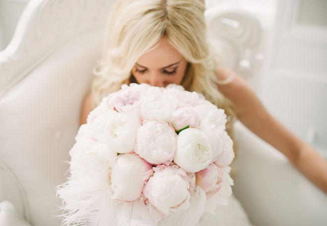 Amazing vintage inspired bouquet. Huge peonies w/ white feathers