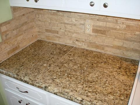 New Venetian Gold Tile Countertop With Mosaic Travertine Tile Backsplash  And Matching Hand Painted Outlet Cover