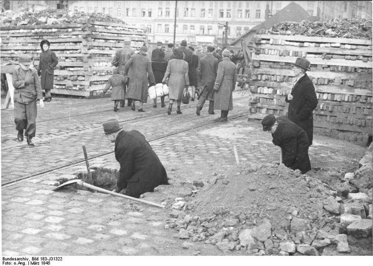 German civilians building a roadblock near the Hermannstraße S-Bahn station, Berlin, 10 Mar 1945