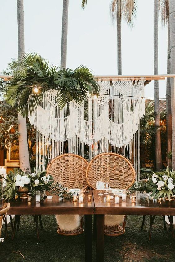 Styling Tropical Beach bohemian Wedding with macrame hanging backdrop, bohemian rattan bride and groom chairs, wood table for outdoor reception
