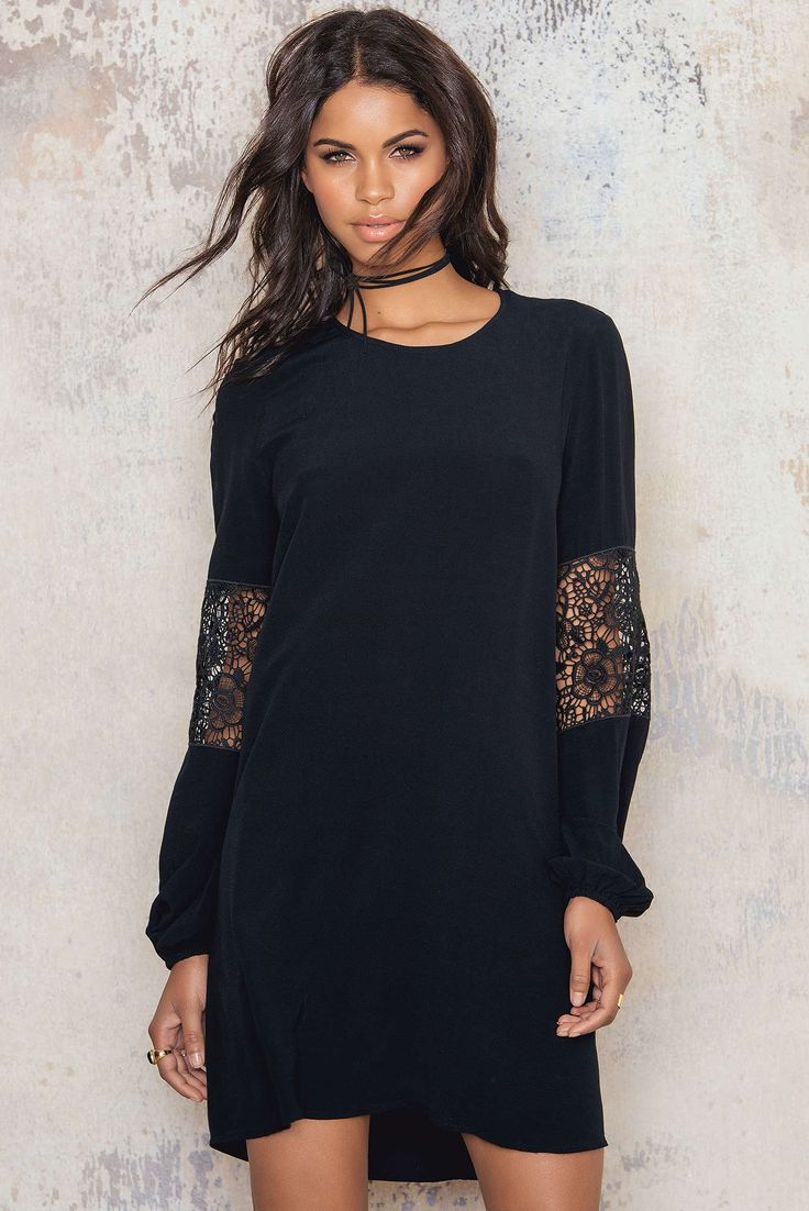 Lace and learn! Lara Dress is a loose fitted dress in black with a rounded neckline. Long sleeves with elastic cuffs for balloon effect. Lace detailing in mid sleeves and as v-shape in the back. Style this with gold jewelry and wavy curly hair to get the perfect romantic look.