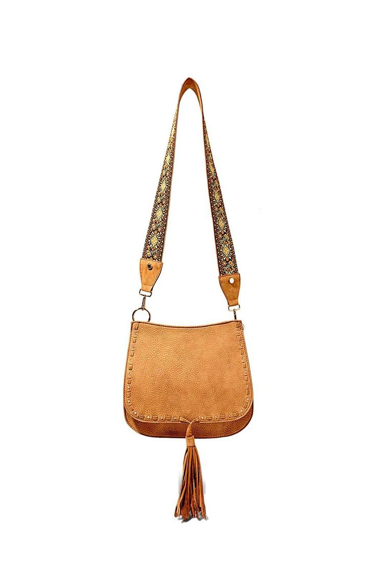 "Bohemian tan saddle bag from Steve Madden with gold grommets and embroidered guitar strap.  Dimensions:10""H x 11""L x 4""W; 18"" drop strap  Tan Saddle Bag by Steve Madden. Bags - Shoulder & Hobo New York"