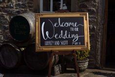 Chalkboard wedding sign at rustic barn wedding venue. Angel at Hetton wedding venue. Yorkshire wedding photographer.