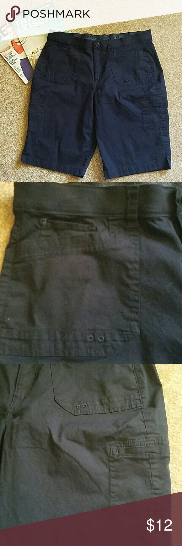 Vanderbilt size 14 navy blue shorts with pockets Waistband measures approximately 35 inches.inseam measures approximately 30 inches  several pockets. Stretchy waistband. Burron and zipper closure.  Great used condition. Gloria Vanderbilt Shorts Cargos