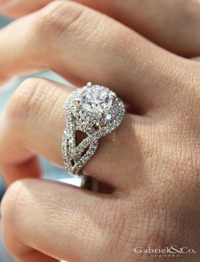 Gabriel & Co. - The perfect platinum halo engagement ring adorned with a stunning diamond remount setting has been beautifully crafted for a love that's made to sparkle. Discover more unique engagement rings on our page!