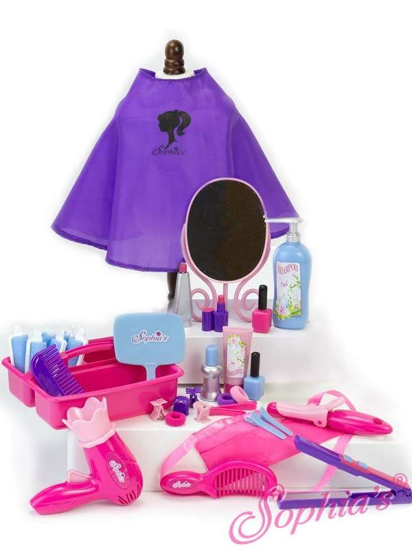 This Hair Salon Set has over 30 pieces to style the doll's hair and give them the full salon experience. The set includes: hair dryer, curling iron, flat iron, hand mirror, table mirror, smock, cape, 4 rollers, 4 long clips, 4 claw clips, shampoo, conditioner/lotion, 2 perfume bottles, 3 hair elastics, 2 combs, 2 bottles of nail polish, 1 lipstick and a storage caddy.  This set is suitable for dolls with hair from 32-50cm.  Recommended for children 5+.