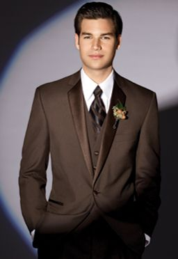 I love the brown tuxedos for a Fall wedding, instead of the black.