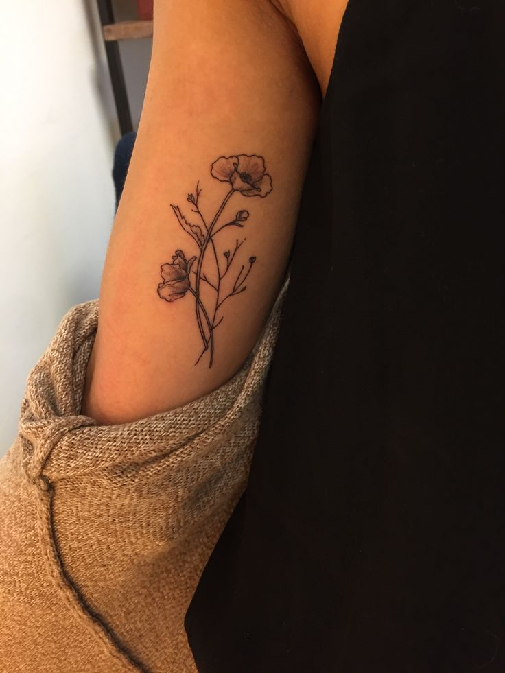 Poppies + wildflower tattoo on inner arm