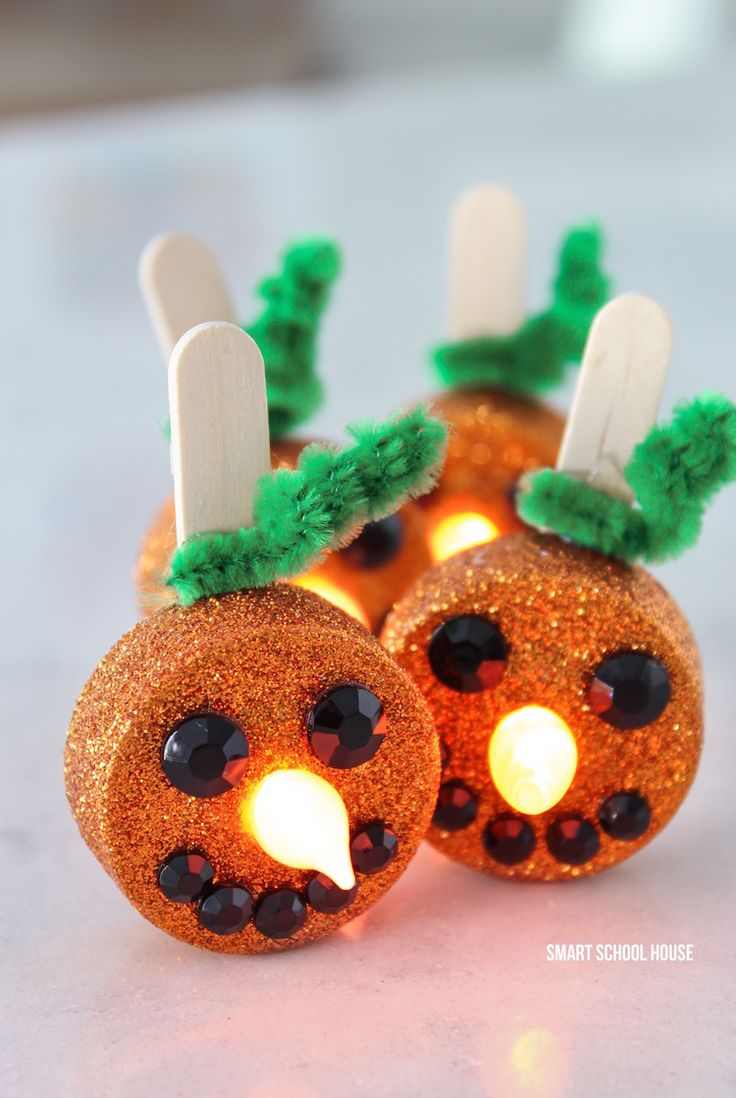 Tea Light Pumpkins - little orange flameless tea lights. Turn on the candle and the flame becomes the glowing pumpkin nose. They are ADORABLE!