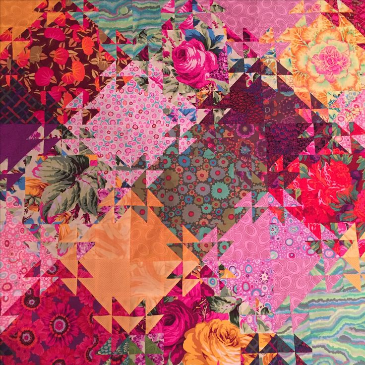 Portion of Kaffe Fassett fabrics Shimmering Triangles quilt. By Debra Caddell