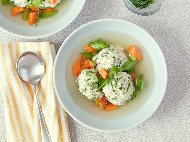 """Chicken Soup Recipe : Ina Garten : Food Network Ina starts by making a homemade chicken stock, which she later uses to cook the matzo balls in. Leave the skins on the onion and garlic - it gives the soup its golden hue, and """"it all gets strained later,"""" Ina says."""