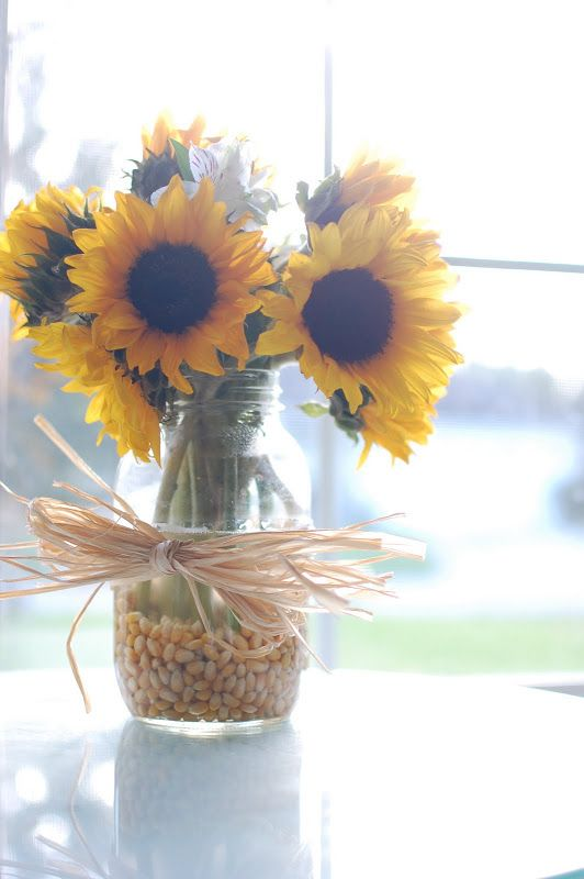 sunflowers in corn kernals with corn husk bow for fall - Sunflower Decorations