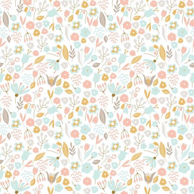 Patrón floral dibujado a mano en colores pastel  Vector Gratis