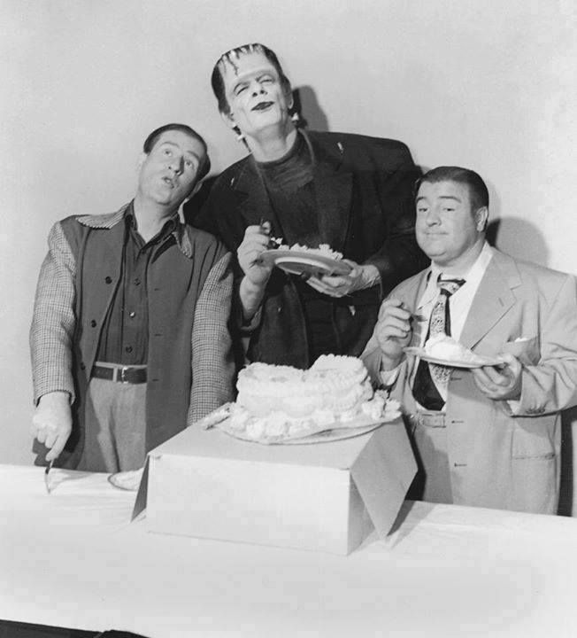 A behind the scenes shot of comic legends Bud Abbott and Lou Costello, with co-star Glenn Strange, celebrating Lou's birthday on the ABBOTT AND COSTELLO MEET FRANKENSTEIN set, circa 1948!