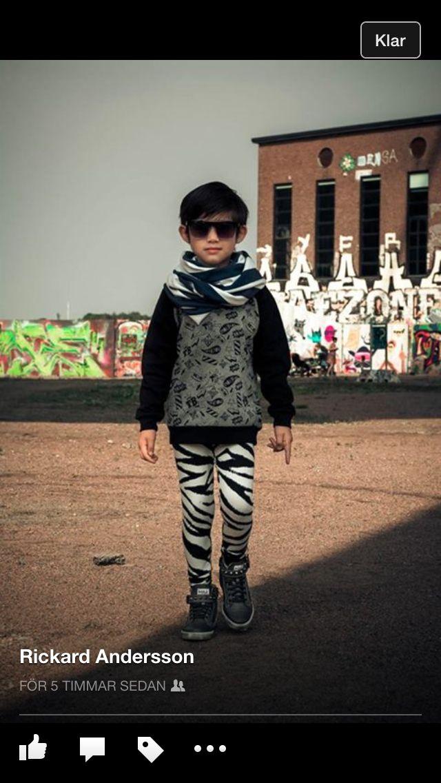 Hero sweat shirt and zebra leggings.