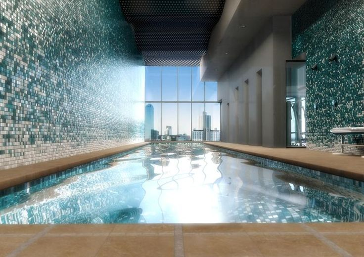 The pool at The Bank Apartments glistens as the sun touches its water. Check our other projects at: salvo.net.au