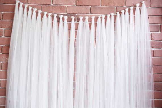Tulle backdrops for your wedding, engagement photos or photo booth. White and Ivory tulle is 12 wide and colored tulle is 6 wide. Each strand is