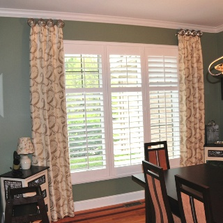 Single width side panels mounted on medallions with plantation shutters inside mounted on the window. A dreamy look for any home. Call Maggie's Place .