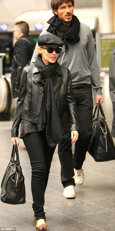 Celebrity Scarf Watch: Kylie Minogue and boyfriend Andres Velencoso wearing artfully tied black scarves at Manchester station.