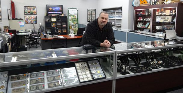 http://www.investingoldnow.com/how-and-where-to-buy-gold-and-silver/  Using a Local Coin Dealer