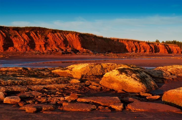 PEI - If you arrive to the Island via Confederation Bridge, one of the longest bridges in the world, you will end up right in the area of the Island called Red Sands Shore. It is named after the red sandstone cliffs along the Northumberland Strait coast which have eroded to create a stunning red sand shore at low tide. You will also be greeted with rolling hills and farmland. Stop in at the enchanting fishing village, Victoria-by-the-Sea with its colourful waterfront fish shacks and small l