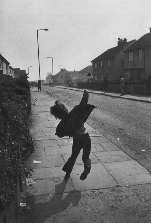 Boy throwing stones at British soldiers in Northern Ireland, 1971 photo by Gilles Peress