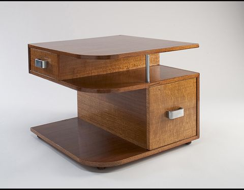 I'm not normally a fan of heywood-wakefield, mainly because I don't really like blonde wood furniture, but this side table design is amazing.