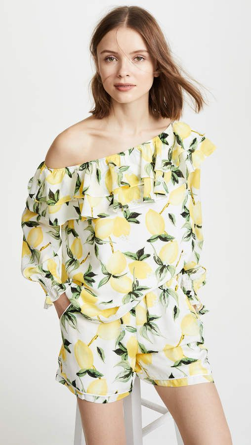 76b12d633b807 A shoulder-baring Ella Moon top with ruffles at the elastic neckline and a  charming lemon print. Ella Moon One Shoulder Ruffle Blouse.