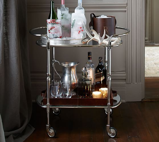 "$400. Brooke Bar Cart | Pottery Barn - (doubles as a side table / accent auxiliary table when not for food/drink). 30.25"" w x 17.5"" d x 29.5"" ht. Also a version for $300 in brass/bronze. Crafted with iron tubing. Features 1 tempered glass shelf and one mirrored shelf. Hand applied finish in Polished Nickel."