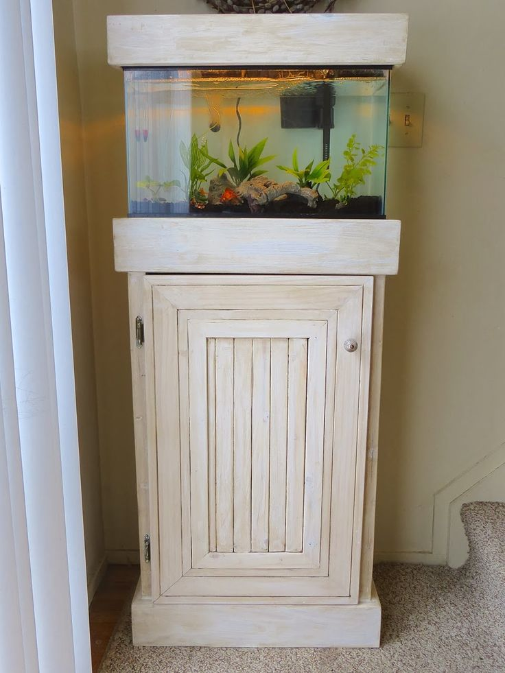 Best 25 fish tank stand ideas on pinterest tank stand for Custom fish tank stand