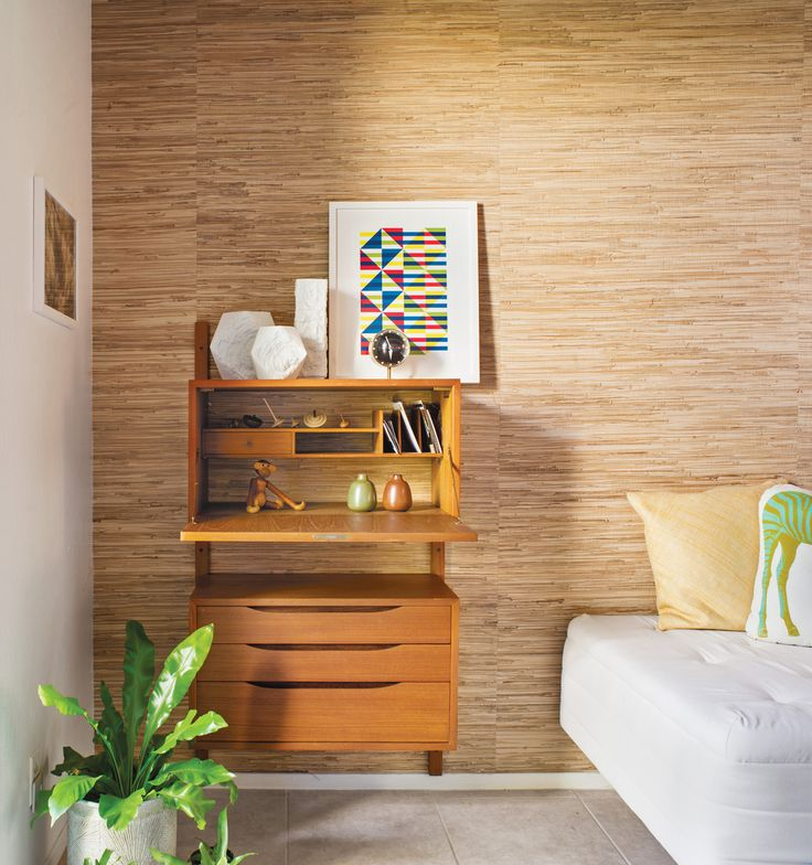 The most changed area of the home is the small guest room–office, where Neely, who works from home, removed the closet doors and added a grass-cloth wall treatment to distinguish it from the rest of the house's decor. Photo by: Drew Kelly