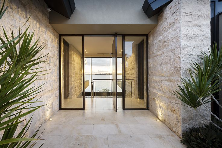 "Statement entry in Urbane Projects ""Natural Balance"" home. Featuring Travertine cladding, sold timber door and the all important two-storey window to show off that picturesque view!"