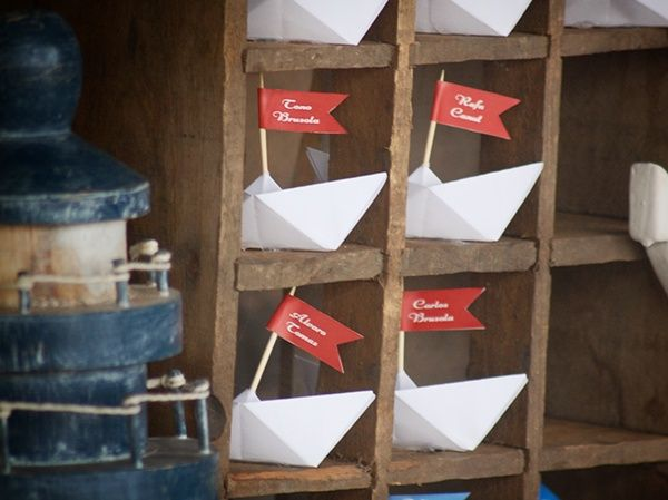 Handmade paper boats and nautical vintage decor seating plan.