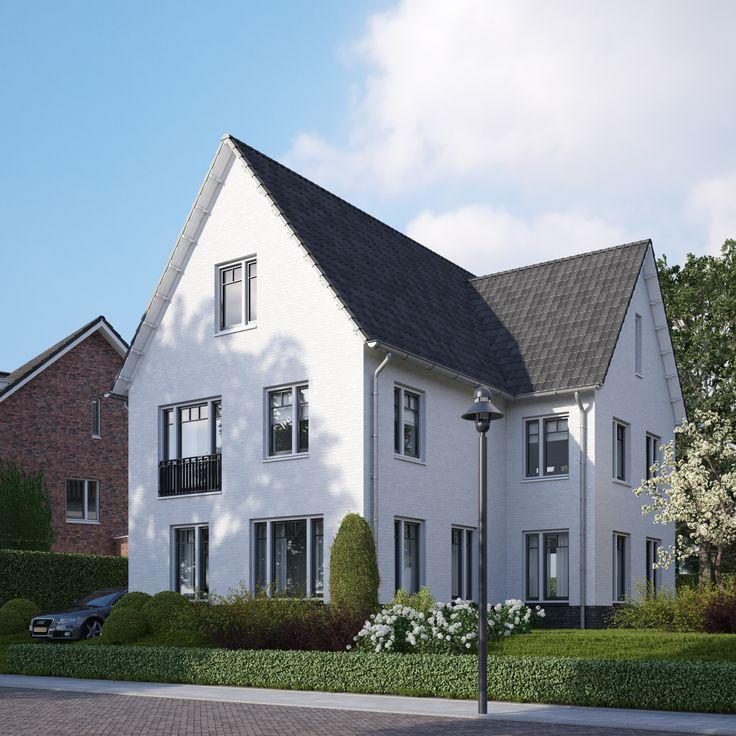 Een vrijstaande woning in klassieke architectuur, met een wit gekeimde gevel.