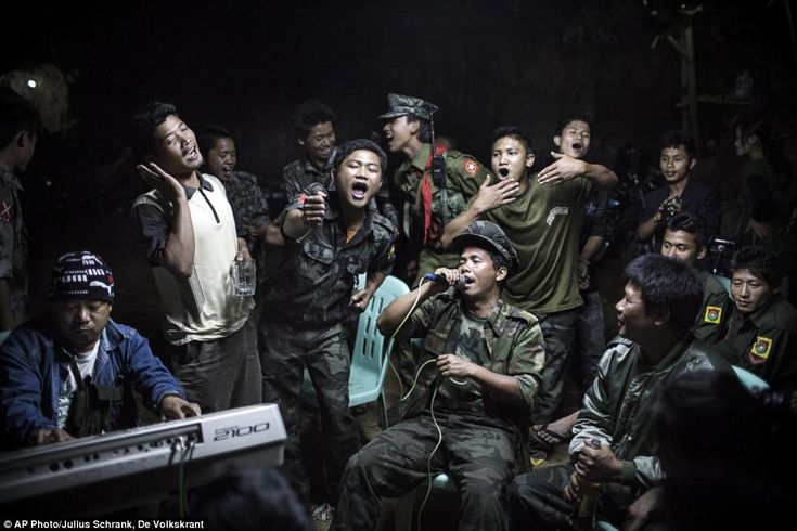 Kachin Independence Army fighters drinking and celebrating at a funeral of one of their co...#Soldier #War #Brave #commitment #dedication