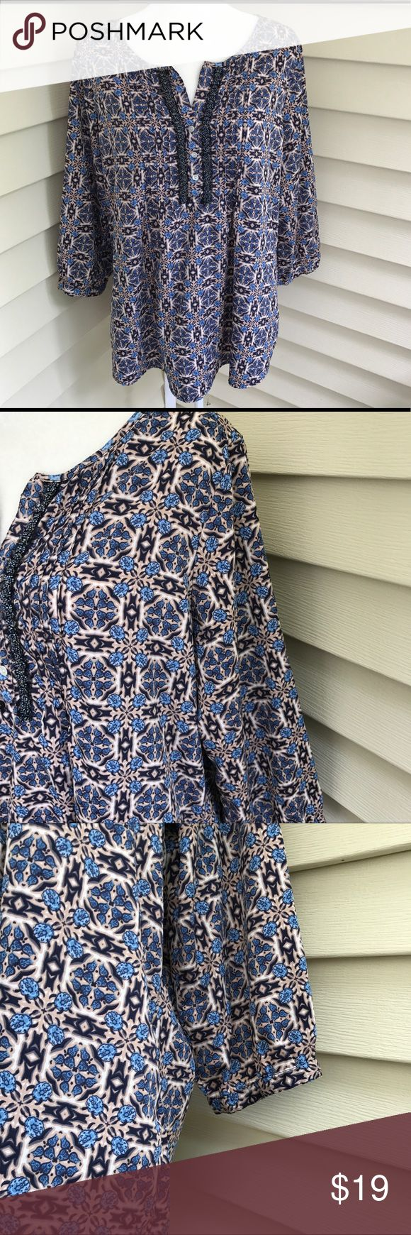"""Dress Barn plus size V-Neck Aztec design top Beautiful top and in excellent condition. V-neck with embellished sequins and 3 buttons. Size 1X. Pit to pit 24"""" pit to hem 17"""". Colors are Blue/Tan/white. 100% polyester. Sleeves are a 3/4. Bin 12 Dress Barn Tops Blouses"""