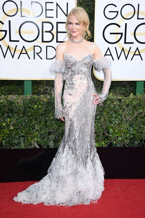 Nicole Kidman proved that all the things that were once ruled too 80's for the aisle–like ruffled mermaid skirts, silver sequins paired with sheer insets and puffed off-shoulder sleeves all work. The actress wowed as she ushered in some much needed maximalism to the Golden Globes red carpet with a runway look from Alexander McQueen's Spring 2017 collection.