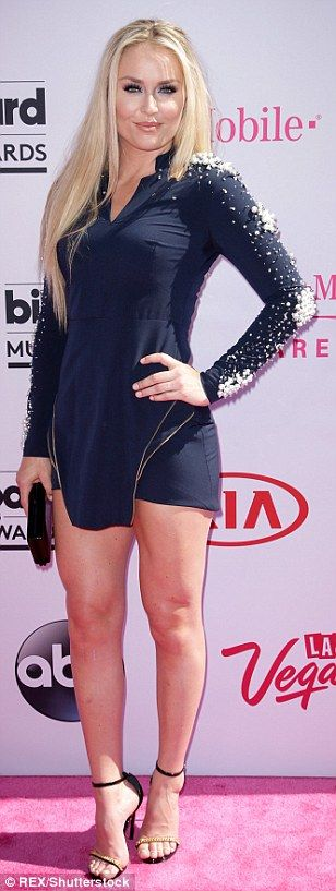 Blonde beauty: Ski star Lindsey Vonn was super leggy in a blue mini dress with pearl embellishments