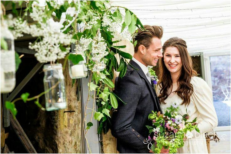 Whimsical garden wedding style. By Through the Looking Glass. @2thlookingglass.  Hanging jars. Soft candle light. Gypsophila and ivy.