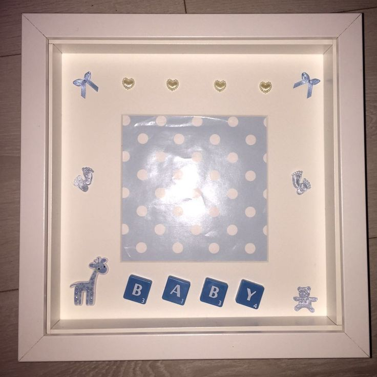 "White Frame - 23 x 23cm (9 x 9"" approx) Tiled message: BABY Detailed with blue tiles, blue giraffe and blue bows.  Personalised picture frame custom made to your requirements.  Available in Black or White frames.  Lettered tiles available in Black, White, Blue or Pink.  Tiles available in a Large or Small font.  Design is bespoke to your request, including buttons, starts, hearts, beads, bows, and a whole lot more embellishments."