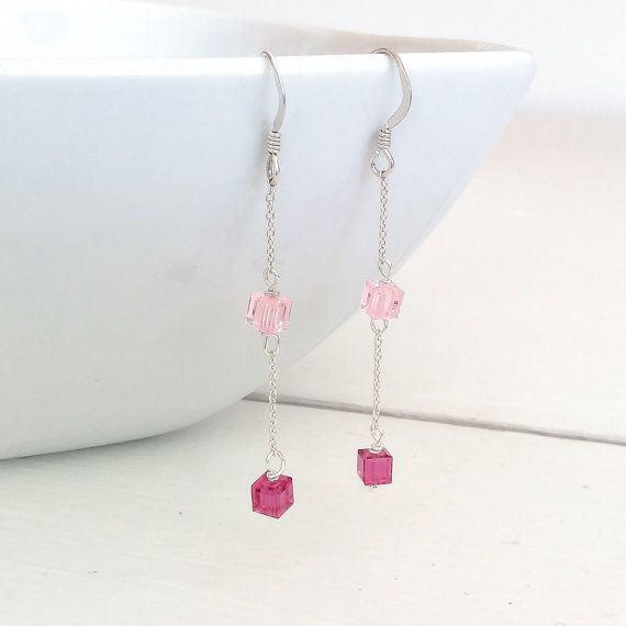 Swarovski crystal and Sterling silver pink earrings with sterling silver chain I have made these beautiful earrings with 4mm Swarovski crystal cubes in pink and purple. I have attached the crystals to a sterling Silver chain and ear wires. All of the metal components are Sterling silver. Sterling silver is a great component because this metal is less likely to cause allergies than other non precious metals. The earrings are 5.5cm long (2 1/4in). I will send these earrings in a beautiful…