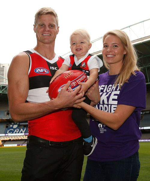 Nick Riewoldt Photos Photos - Nick Riewoldt of the St Kilda Saints, son James and wife Catherine pose for the media ahead of his 300th AFL match at Etihad Stadium on March 30, 2016 in Melbourne, Australia. - Nick Riewoldt Photo Opportunity