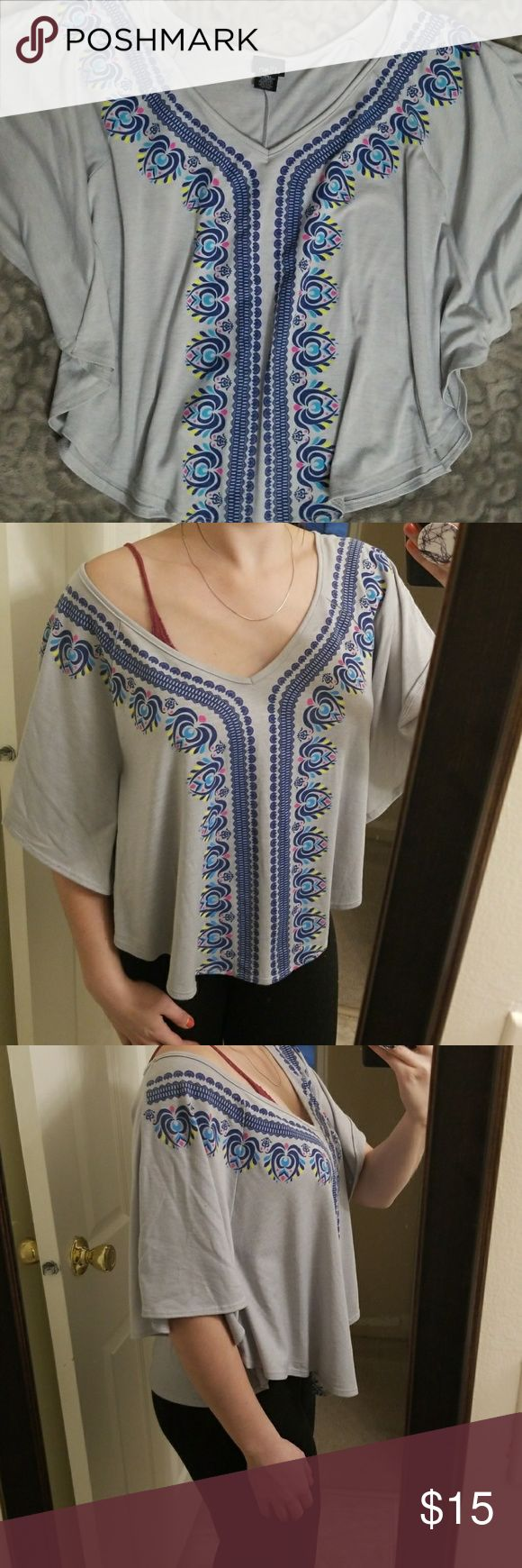 Batwing Top Small batwing style top, light blue/gray with blue, link, yellow, navy detail Rue 21 Tops