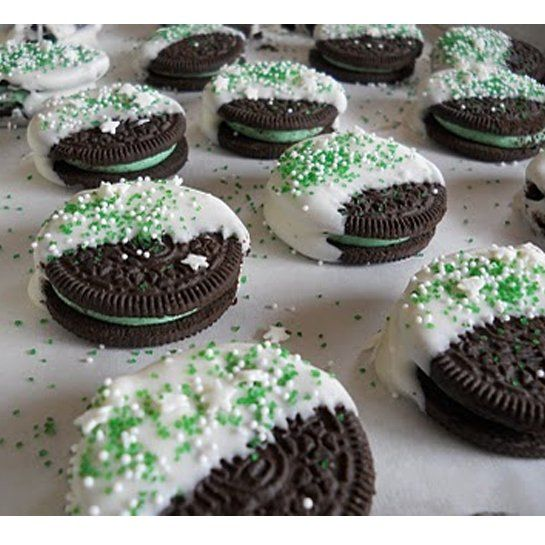 Quick and easy dessert: Mint Oreo cookies dipped in melted almond bark with sprinkles