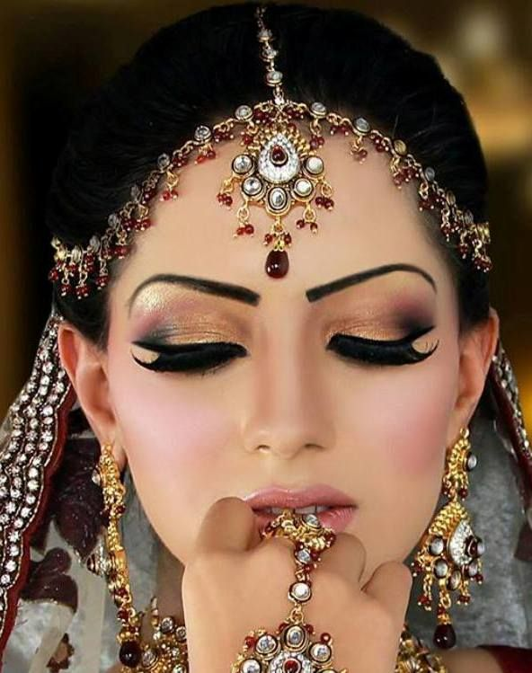 I saved this pin not for the makeup, but for the jewelry she is wearing. She has the head thing, and she has big earrings, and jewelry on her hand. Plus everything goes together. This represents the style of Persian women.